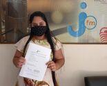 Natiele Ferreira, veio retirar o prêmio da Elza Esquivel Benites, ganhadora do Barril de Chopp da heineken
